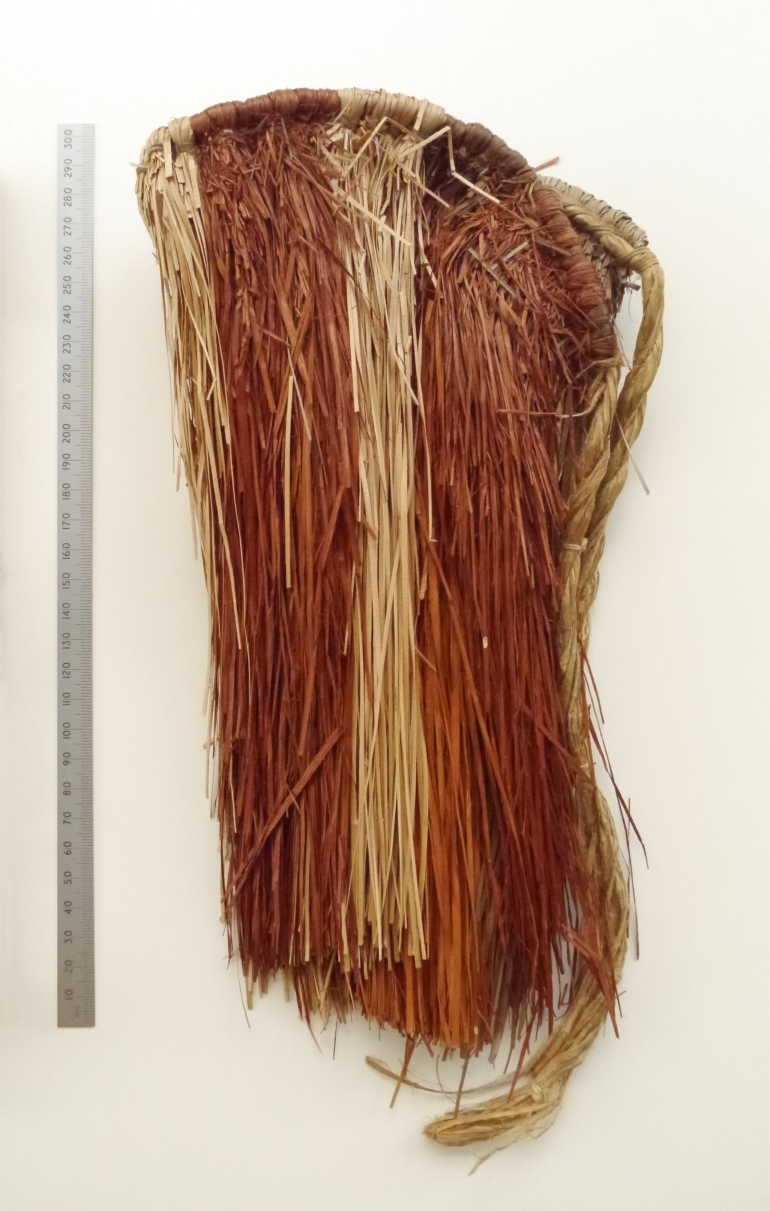 Small native woven grass skirt made in the Pacific during WW2 for Colleen Noonan. Part of the exterior shown.