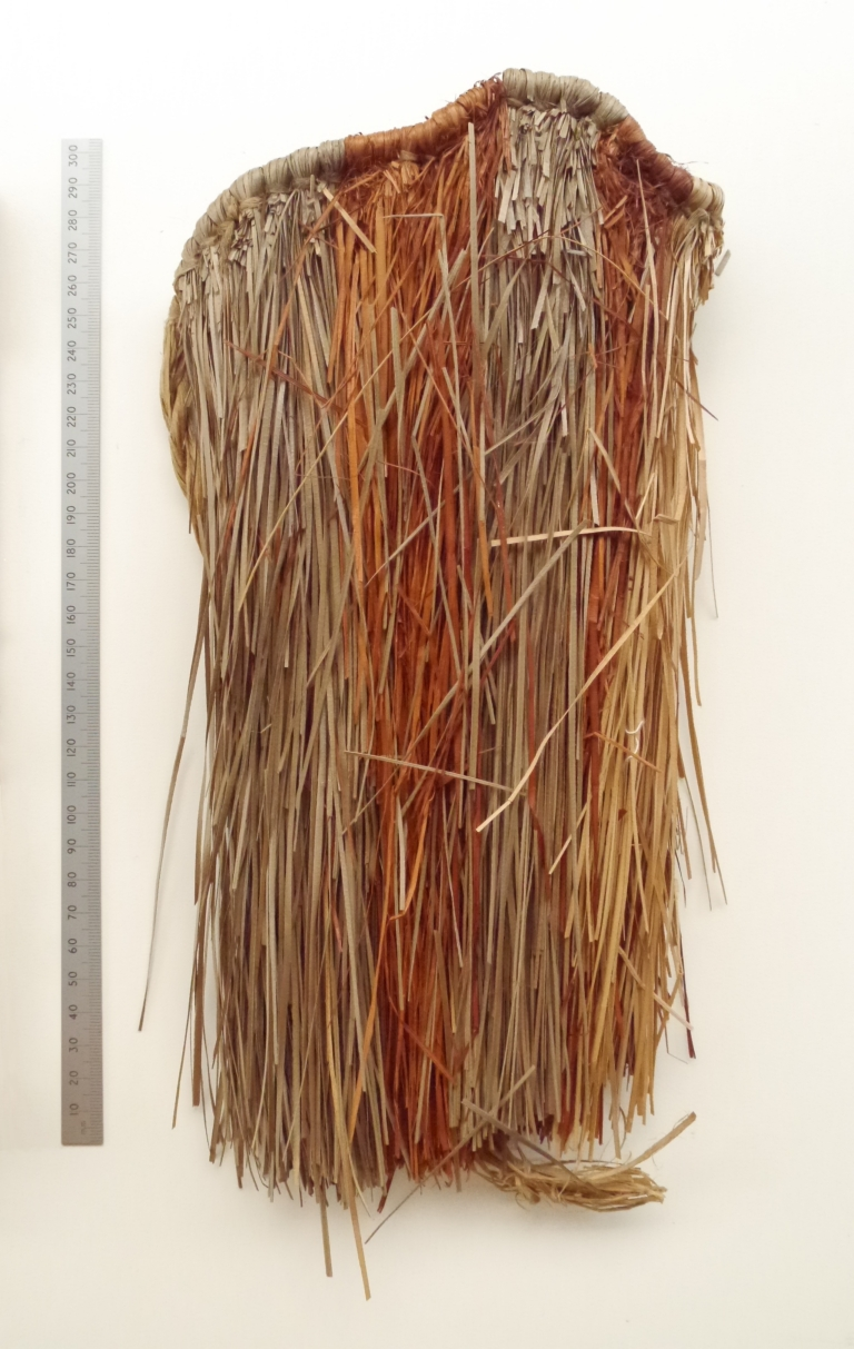 Small native woven grass skirt made in the Pacific during WW2 for Colleen Noonan. Another part of the exterior shown.