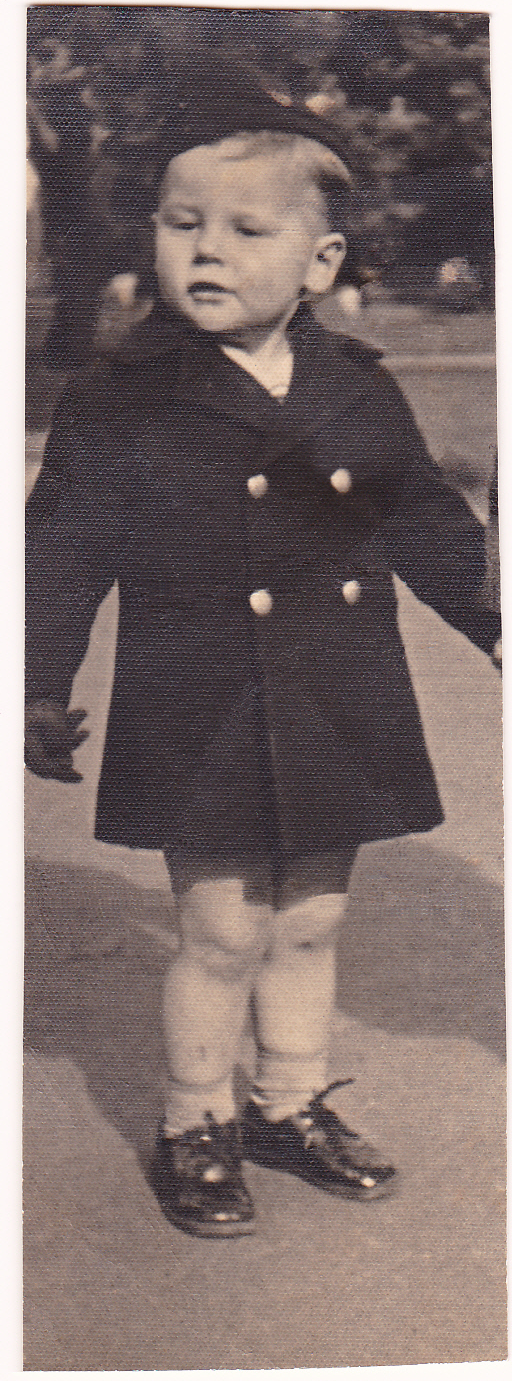 Restored print of Barry Noonan aged two and a half years (c.1941) in an air force coat and cap made for him by Shirley and her mother-in-law Mater Noonan.