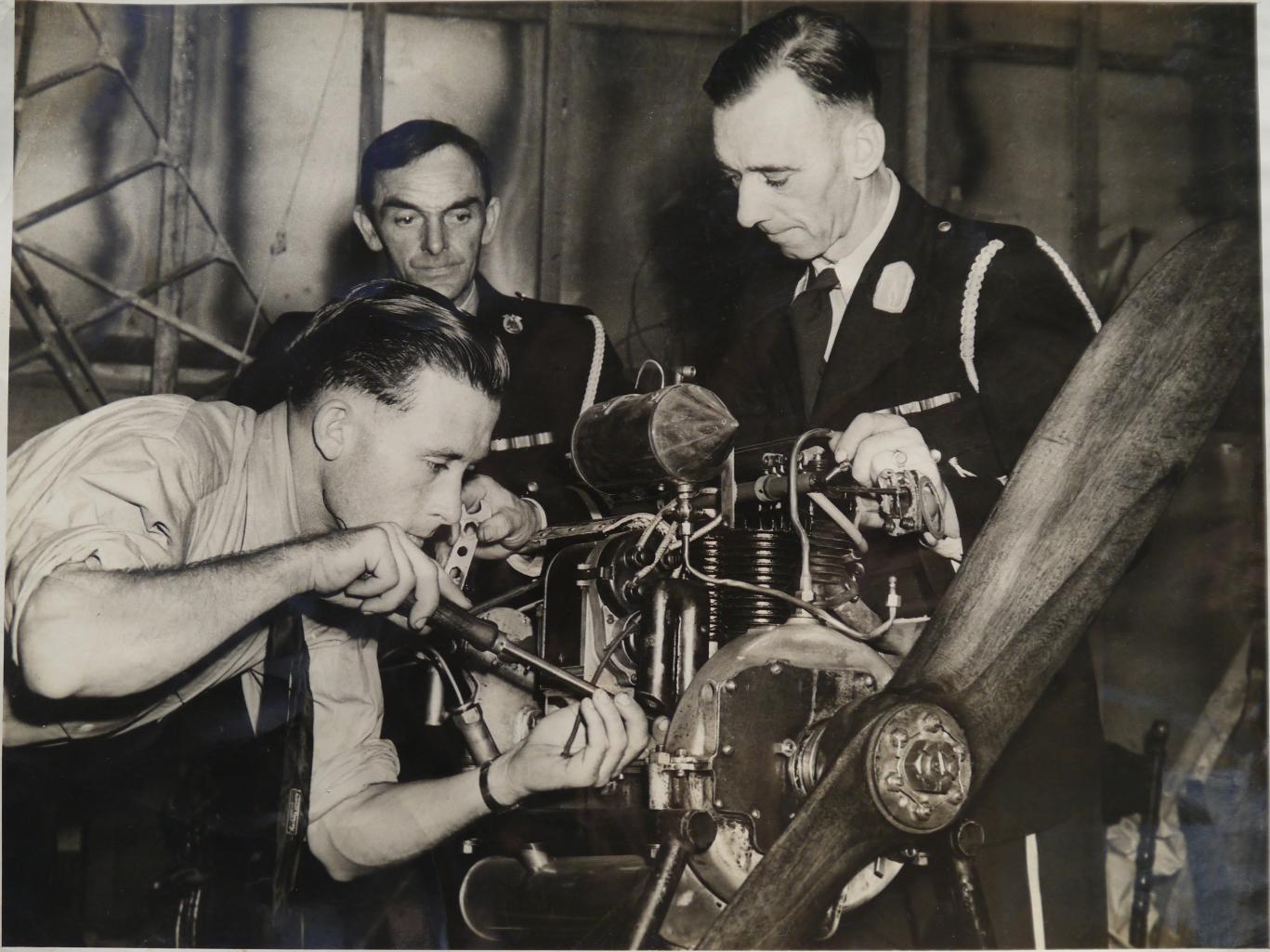 Cadet Clem Noonan (L), Mr Duffey and Newcastle Air League Divisional Commander J. Cox (R)